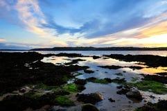 White Bay. Evening sun sinks to horizon at White Bay, Co.Cork, Ireland Stock Images