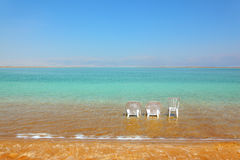 White beach armchairs and a chair Stock Image