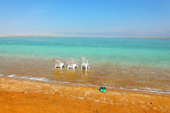 White beach armchairs, chair and slippers Stock Photography