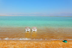 White beach armchairs and slippers Royalty Free Stock Photography