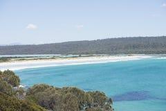 White beach Bay of Fires Tasmania, Australia. Panoramic view of coastline at Bay of Fires, Tasmania, Australia, with clear turquoise water, white sandy beach and Royalty Free Stock Photos