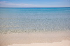 White beach and blue water Stock Photography