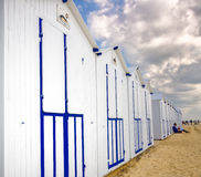 White beach cabins in a row on Franch coast. Normandy Royalty Free Stock Image