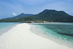 White beach camiguin island mindanao philippines. White beach overlooked by volcanos on camiguin island near mindanao in the philippines Royalty Free Stock Image