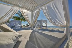 White beach canopies. Luxury beach tents at tropical resort, luxurious vacation and holiday concept t royalty free stock photography