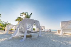 White beach canopies. Luxury beach tents at tropical resort, luxurious vacation and holiday concept t stock image