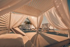 White beach canopies. Luxury beach tents at tropical resort, luxurious vacation and holiday concept t stock photography