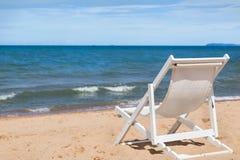 White beach chair on the beach. Stock Image