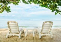 White beach chairs on beach Stock Photo
