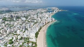 White beach and the city in Puerto Rico Island stock video footage