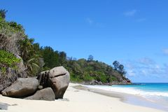 White beach and granite rocks by the sea on Seychelles Stock Photos
