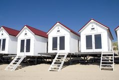White beach-houses. White little beachhouses on a row royalty free stock photography