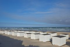 White beach huts on the beach stock images