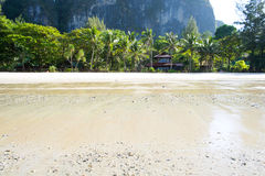 White beach krabi thailand. Andaman Sea still sunshine, white beach,Thailand, Tropical beach, long tail boats, Thailand, Long tail boats on beach,Andaman Sea Royalty Free Stock Image
