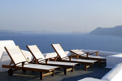 White beach loungers. On the terrace Stock Photography