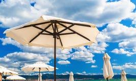 White beach parasols Royalty Free Stock Photography