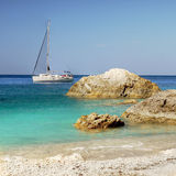 White Beach and Sailboat Stock Images