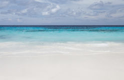 White beach sand and beautiful blue sea. And sky Royalty Free Stock Photos