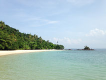 White beach and Sea with crystal clear tropical waters. Malaysia Royalty Free Stock Images