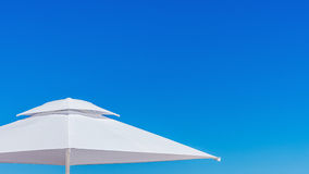 White beach umbrella Stock Photography