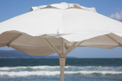 White beach umbrella. Close up Royalty Free Stock Photos