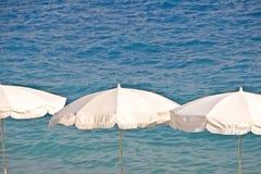 White beach umbrellas Stock Photography
