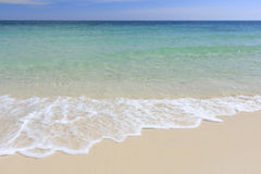White beach, wave and summer tropical sea background. Stock Photo