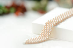 White beaded bracelet on a textile background Stock Photo