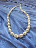 White beads on blue background Stock Photo