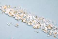 White beads in a pile, blue surface. royalty free stock photos