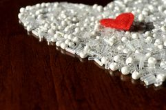 White beads and red heart. Copy space. Royalty Free Stock Photography