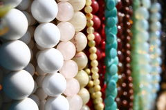 White beads row. A lot of beads, white perls in focus Royalty Free Stock Images
