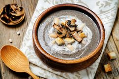 White bean mushrooms soup with croutons stock photography