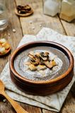 White bean mushrooms soup with croutons stock photo