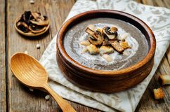 White bean mushrooms soup with croutons royalty free stock photo