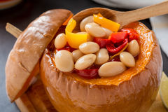 White bean and red pepper stew in pumpkin bowls Stock Photo