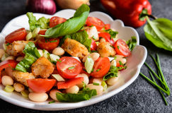 White bean salad with fried fish, red pepper, green onion and chive Royalty Free Stock Images