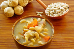 White bean soup. Nutrient soup made of beans, bacon, carrot and dumplings Stock Image