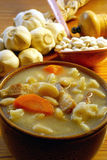 White bean soup. Nutrient soup made of beans, bacon, carrot and dumplings Stock Images