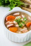 White bean soup made of  beans, carrot and ham Stock Images