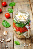White beans cucumber tomato red pepper feta spinach salad in a j Royalty Free Stock Photo