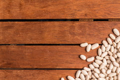 White Beans Frame. Over a wooden table Royalty Free Stock Photography