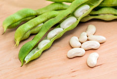White beans. Green pod white beans close-up on a wooden table. vegetables, cereals. macro Royalty Free Stock Photography