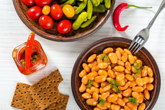 White Beans, pickled cabbage, cherry tomatoes, cucumbers, chili Stock Images