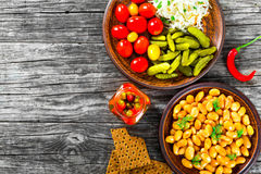 White Beans, pickled cabbage, cherry tomatoes, cucumbers, chili Stock Image