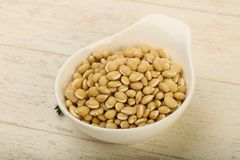 White beans. Raw White beans in the bowl over wooden background Royalty Free Stock Photography