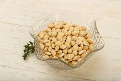White beans. Raw White beans in the bowl over wooden background Royalty Free Stock Image