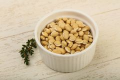 White beans. Raw White beans in the bowl over wooden background Stock Photo