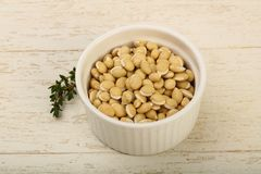 White beans. Raw White beans in the bowl over wooden background Stock Images