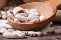 White beans with red spots in the wooden spoon Royalty Free Stock Photos